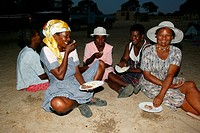 Women of the community gathering under the village tree, Sehitwa, Botswana, Africa