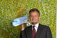 Michael Frenzel, chairman of the TUI AG with a model airplane