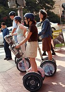 Young people on Segway personal transporters, Downtown, Washington DC, United States, USA