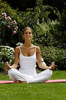 Woman sitting cross_legged, doing yoga exerceses, Meditation, Relaxation, Wellness, Holiday, South Tyrol, Italy