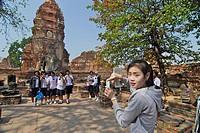Thai school girls visiting Historical Park, Ayutthaya, Wat Mahatat, Thailand, Asia