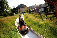 Tourists on the summer toboggan run in Karpacz, Bohemian mountains, Lower_Silesia, Poland, Europe