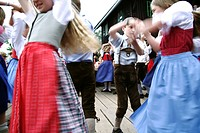 Children wearing traditional costumes dancing, Styria, Austria