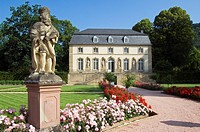 Statue and pavilion in the monastery garden in Echternach, Luxembourg.