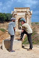 Tourist and guide at the Roman ruins of Leptis Magna, Tripoli, Libya, Africa
