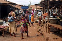 Women with babies on their backs are shopping at market in Tsevie, Togo, Africa