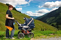 woman with buggy in the mountains, Alps