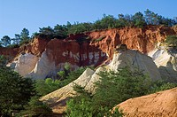 Different coloured layers of rock and erosion in the old ochre quarry, known as the Colorado Provençal at Rustrel, Provence, France