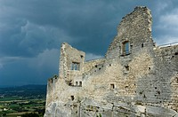 Ruin of the Marquis de Sade castle overlooking the mediaeval village Lacoste, Provence, France