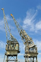 Historic dock cranes at the shipping trade museum in Antwerp, Belgium