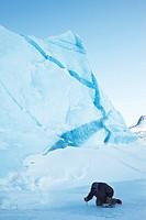 young inuit picking ice for drinking water abstraction, Greenland, Ostgroenland, Tunu, Kalaallit Nunaat, Liverpool Land, Lillefjord, Kangertivatsiakaj...