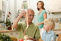 Grandpa peels an apple for his grandson