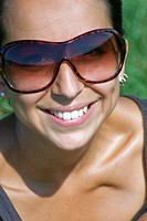 young woman with sun shades in portrait