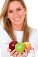 beautiful blond woman holding apples in her hands, smiling