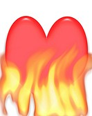 Concept photo illustration of a heart on fire with flames underneath Could refer to love and passion or just heartburn
