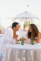 Couple in robes eating outside