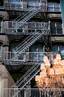 fire escape at high_rise building and morror image of a lamp, USA, New York City