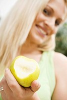 beautiful young, blond with a green apple