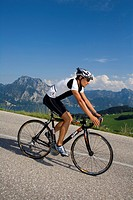 man on a racing bicycle in an alpine scenery, Austria