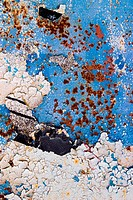 detail of a wall with blue old cracked peeling paint