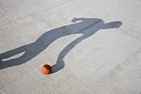 Shadow playing basketball