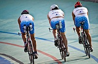 Trio of triathletes training on the bike in a velodrome in Alcobendas Madrid / Trio de triatletas entrenando en la bicicleta en un velodromo de Alcobe...