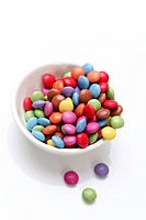 Coloured chocolate drops in a white bowl