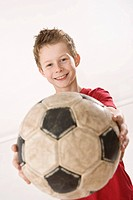 Portrait of a smiling boy with a football