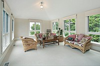 Second floor family room with wicker furniture