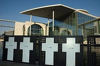 Berlin Germany Marie Elisabeth Lüders Haus and white crosses commemorate people that lost their lives attempting to escape to West Berlin