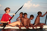 Traveller on a Kayak in Lake Malawi with local children