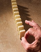hand-with-dominoes