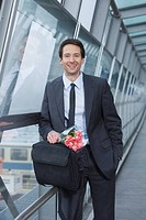 businessman with flowers, happy