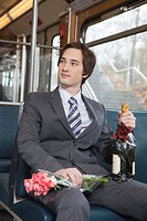 businessman in tube, champagne, flowers
