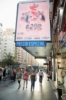 Women walking in Gran Via, Madrid, Spain