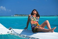 woman sunbathing on catamaran,Tobago Cays,Grenadines islands,Saint Vincent and the Grenadines,Winward Islands,Lesser Antilles,Caribbean Sea