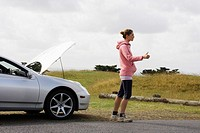 A female hitchhiker with a car problem