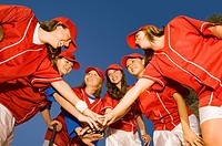 Women's softball team in huddle low angle view