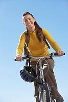Young woman riding mountain bike low angle view.