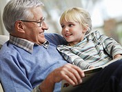 Grandfather reading to girl 3_4 close_up