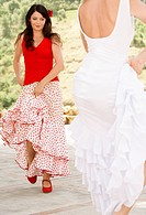 Two women flamenco dancing outdoors