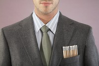Young businessman with pencils in pocket close_up portrait