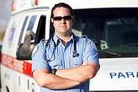 Paramedic worker standing in front of ambulance portrait (thumbnail)