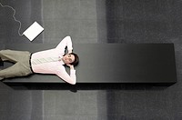 Businessman Lying down on Bench view from above