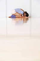 Dancer crouching in prayer position (thumbnail)