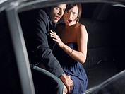 Couple in back of limousine (thumbnail)