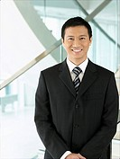 Confident Businessman standing hands clasped
