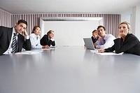 Bored Businesspeople Sitting in Conference Room (thumbnail)