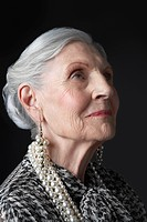 Senior Woman with Pearl Earrings looking up (thumbnail)