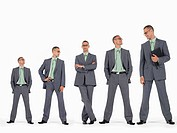Row of businessmen in ascending order of height
